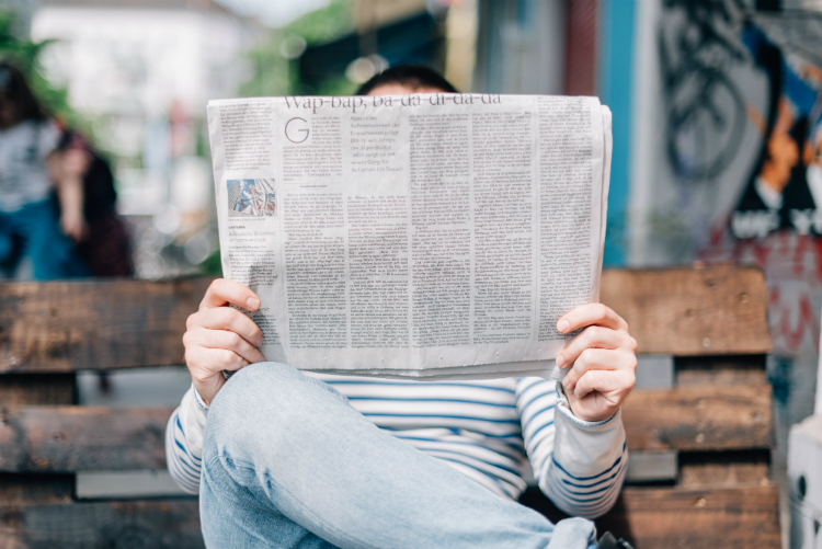 Image result for reading book newspaper